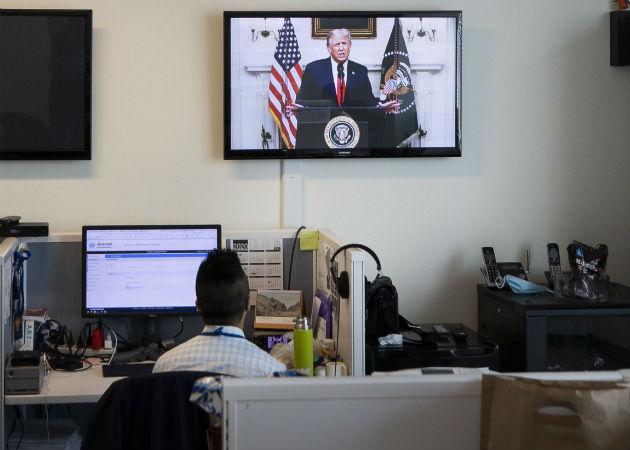 El discurso de Trump en la ONU es visto por televisión en una de las oficins del organismo mundial en Nueva York. Foto: EFE