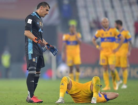 Jugadores del Tigres lamentan la derrota ante los alemanes. Foto: EFE