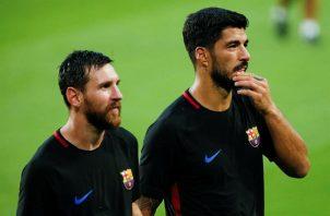 Messi y Suárez durante unos entrenamientos con el Barcelona.Foto:EFE