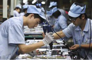 """Wang destacó además que el menor crecimiento de la oferta y la demanda """"puso más presión"""" sobre el mercado de trabajo. EFE"""