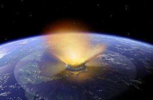 Recreación del impacto de un asteroide sobre la superficie de la Tierra. Foto: EFE