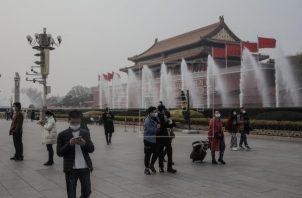 La Comisión Nacional de Sanidad de China informó hoy de 21 nuevos casos de covid-19 en el país. Foto: EFE