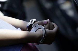 A la mujer se le imputó cargo por el delito de homicidio doloso agravado. Foto Ilustrativa