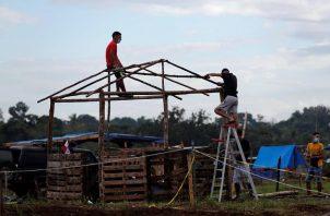 La invasión de terrenos se ha convertido en un negocio. Foto: EFE