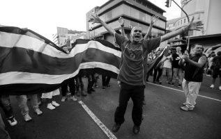 Costarricenses se manifiestan, 19 de agosto, en contra del ingreso de nicaragüenses que piden refugio. EFE